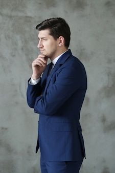 Businessman posing standing, serious