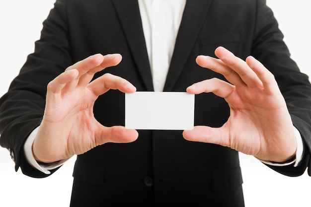 Businessman presenting business card with hands