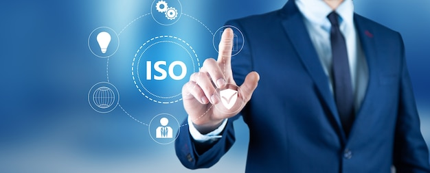 Businessman pressing button on touch screen interface and select iso