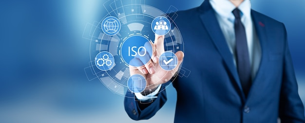 Businessman pressing button on touch screen and select iso