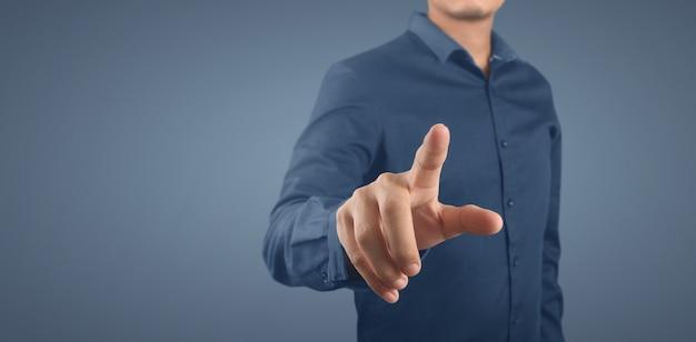 Businessman pressing button virtual screen. hand pointing futuristic interface