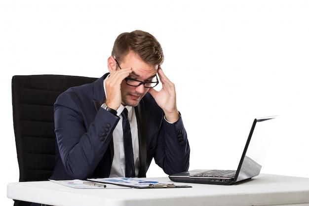 Businessman pressing his head