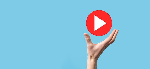 Businessman pressing, hold play button sign to start or initiate projects.video play presentation. idea for business, technology.media player button. play icon.go.