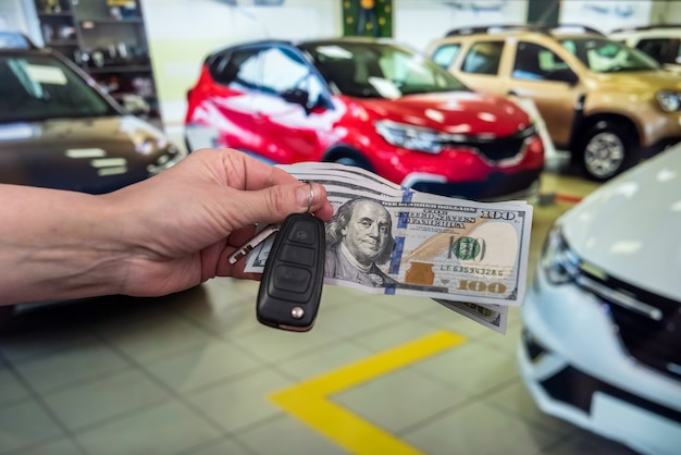 Businessman purchase new car in showroom giving dollars money and taking keys from car, finance concept