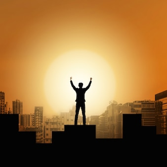 Businessman raise arms up in victory moment