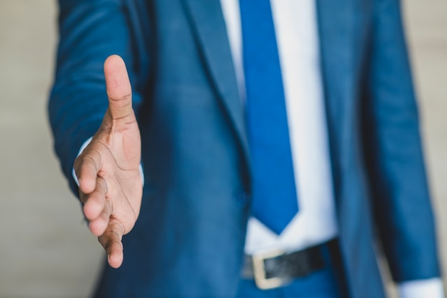 Businessman reaching out his hand