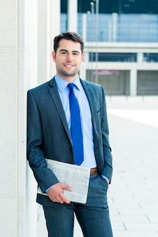 Businessman reading  business newspaper