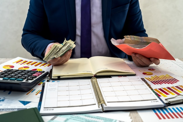 Businessman receives hidden income in an envelope from the company