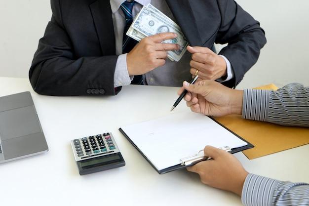 Businessman receiving a bribe