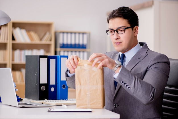 Businessman receiving parcel in office