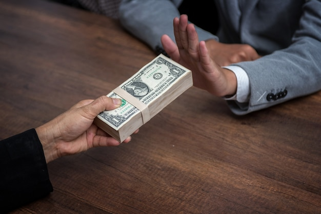 Businessman refusing money offered by a man
