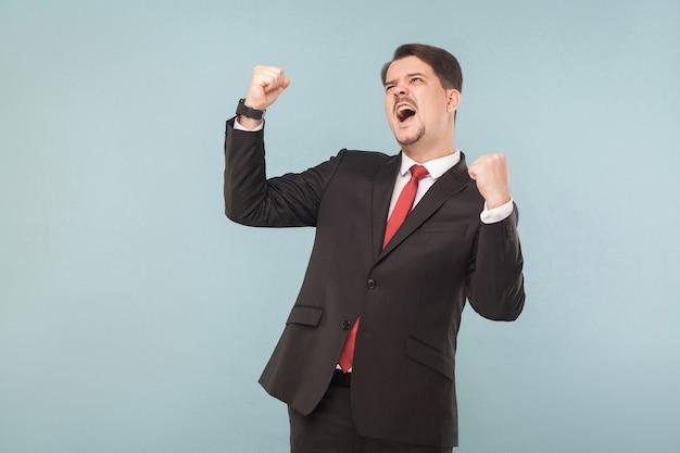 Businessman rejoicing win