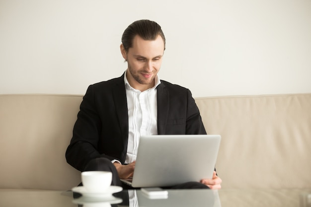 Businessman remotely managing his ecommerce company