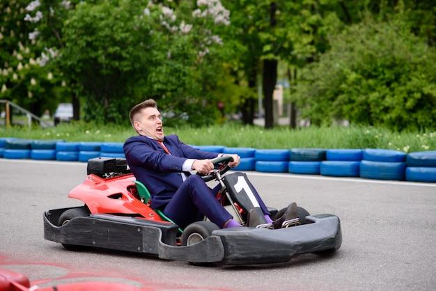 Businessman riding on karting Premium Photo