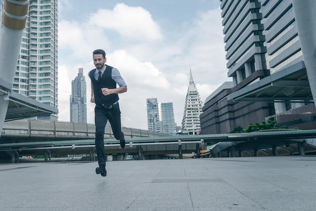 Businessman run at city