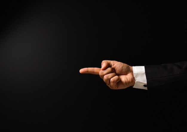 Businessman's hand finger pointing
