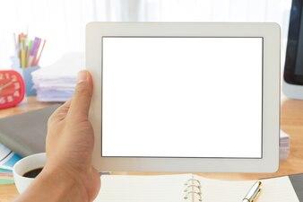 Businessman 's hand holding tablet.