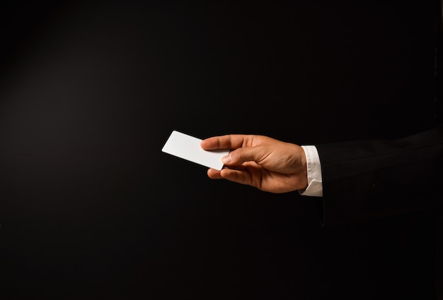 Businessman's hand with blank business card