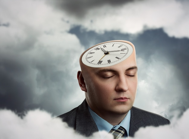 Businessman's head with clock instead of hair