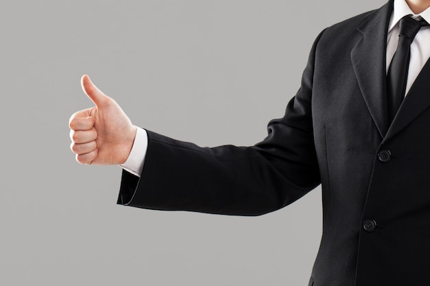Businessman's torso with thumb up