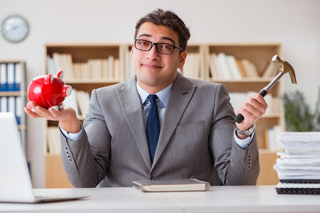 Businessman in search of his savings with piggy bank