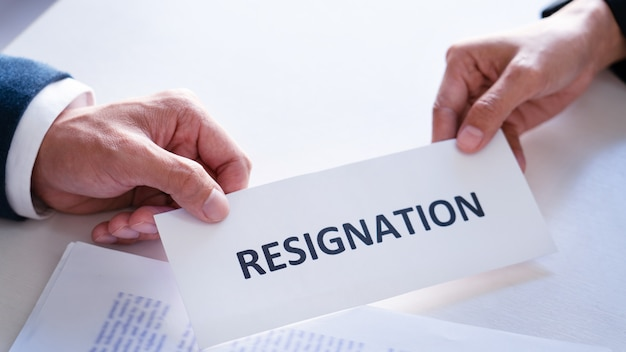 Businessman sending resignation letter to the executive employer