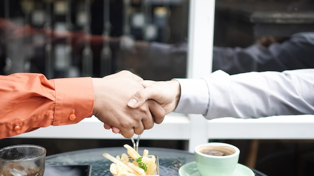 Businessman shake hands  finish the meeting