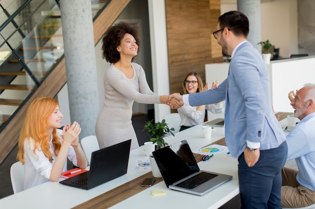 Businessman shaking hands to seal a deal with his female partner