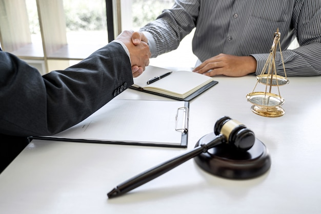 Businessman shaking hands with professional lawyer after discussing good deal