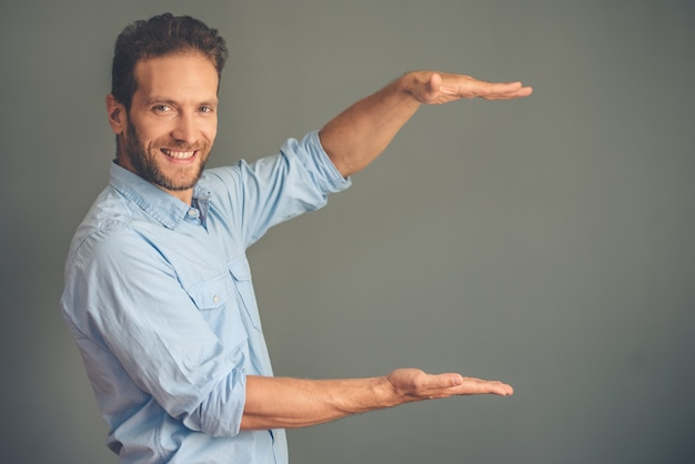 Businessman in shirt is presenting something.