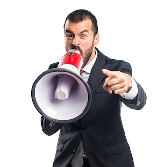 Businessman shouting by megaphone