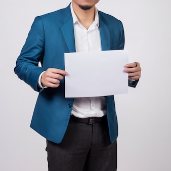 Businessman showing  blank white paper.