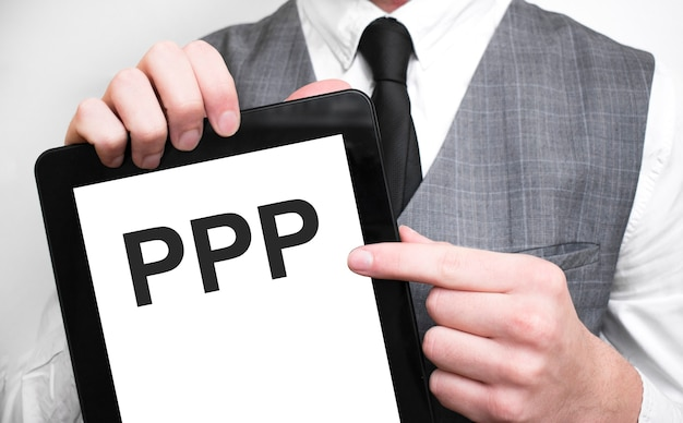 Businessman showing business concept on tablet standing in office ppp