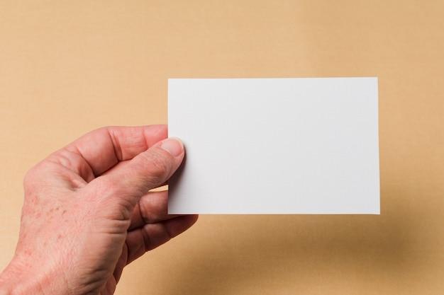 Businessman showing card