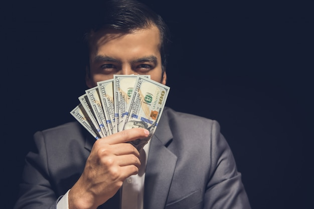 Businessman showing financial earings in us dollars.