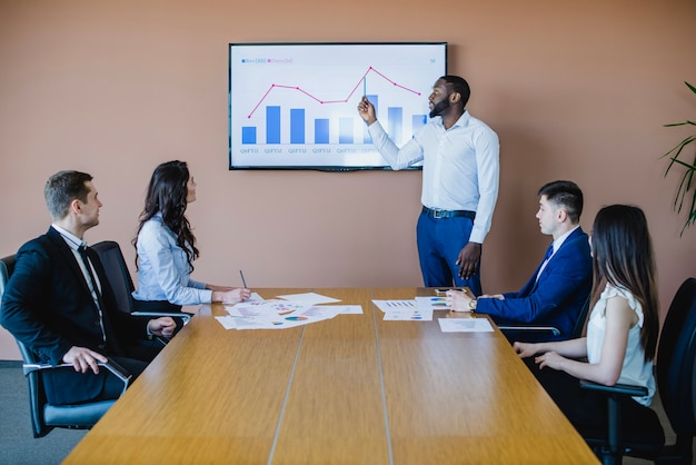 Businessman showing graph on board