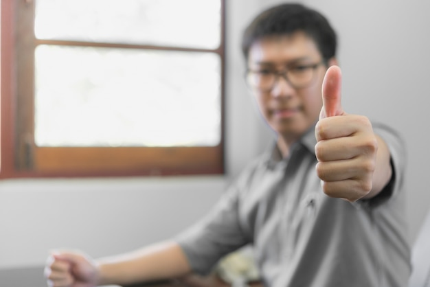 Businessman showing his thumb up, people celebration success working successful concept