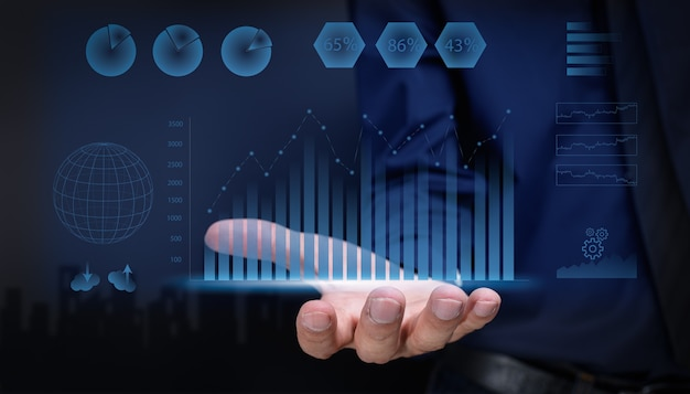 Businessman showing hologram display stock investment growth graph