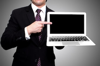 Businessman showing laptop