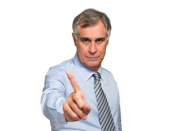 Businessman showing no sign against a white background