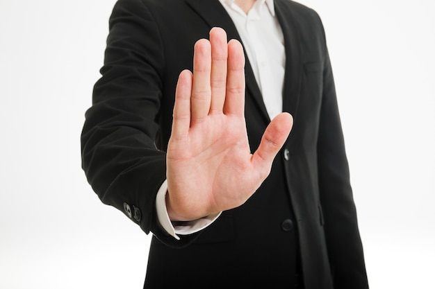 Businessman showing palm of hand