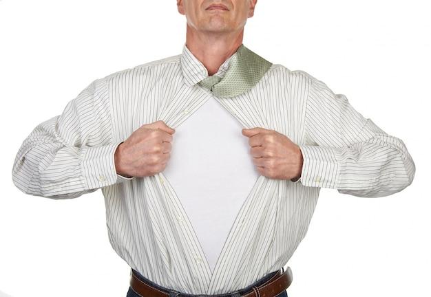 Businessman showing a superhero suit underneath his shirt