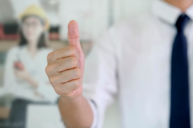 Businessman showing thumbs up - closeup shot.