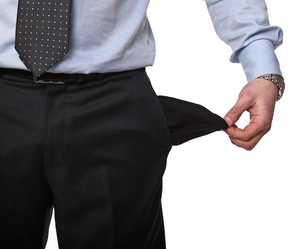 Бизнесмен показывает свой пустой карман, изолированные на белом фоне