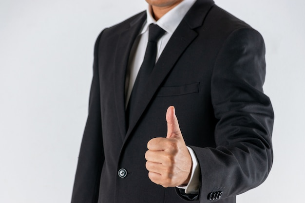 Businessman shows thumb up sign gesture.