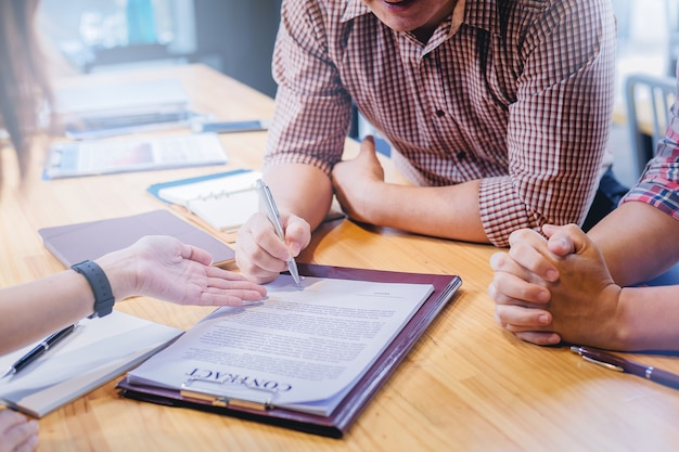 Businessman sign in contract with partnership in meeting