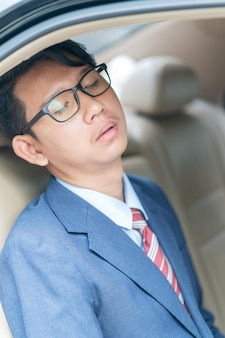 Businessman sit in the backseat of a car