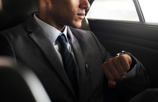 Businessman sit inside car waiting