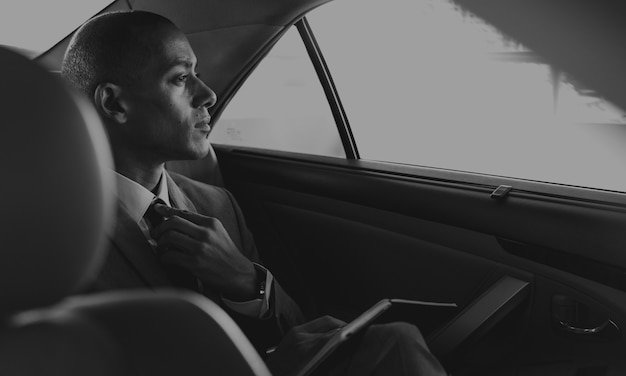 Businessman sit inside car worried