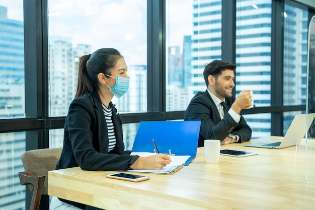 Businessman sitting in job interview,portrait of young woman having job interview with manager and secretary in financial company.